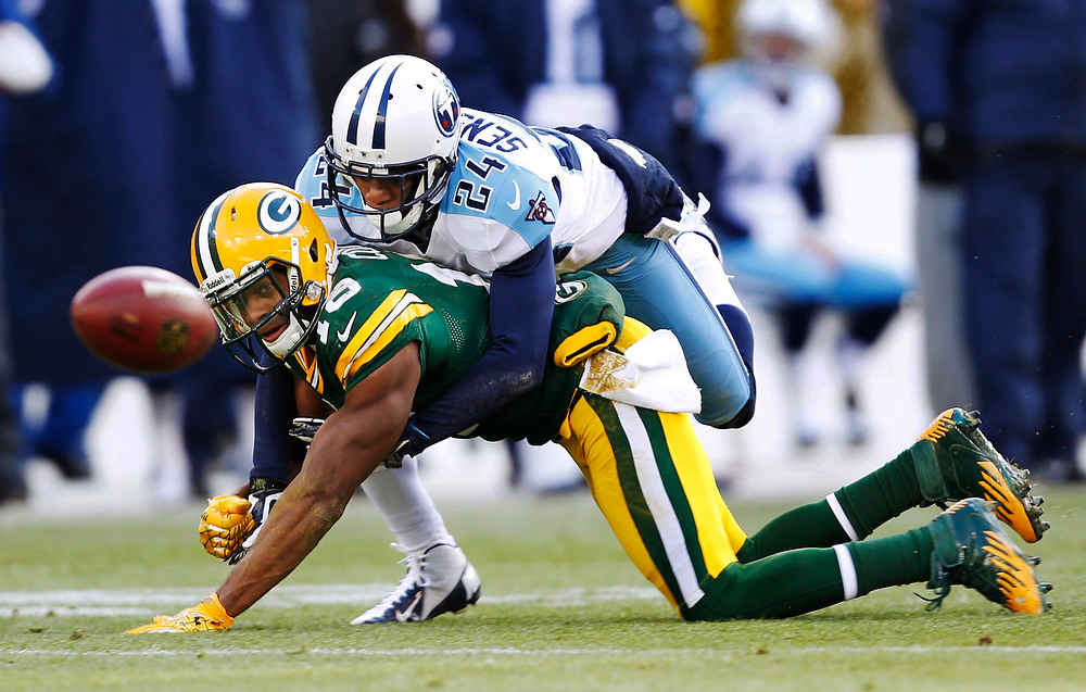 . Tennessee Titans\' Coty Sensabaugh (24) breaks up a pass intended for Green Bay Packers\' Randall Cobb (18) during the first half of an NFL football game Sunday, Dec. 23, 2012, in Green Bay, Wis. (AP Photo/Mike Roemer)