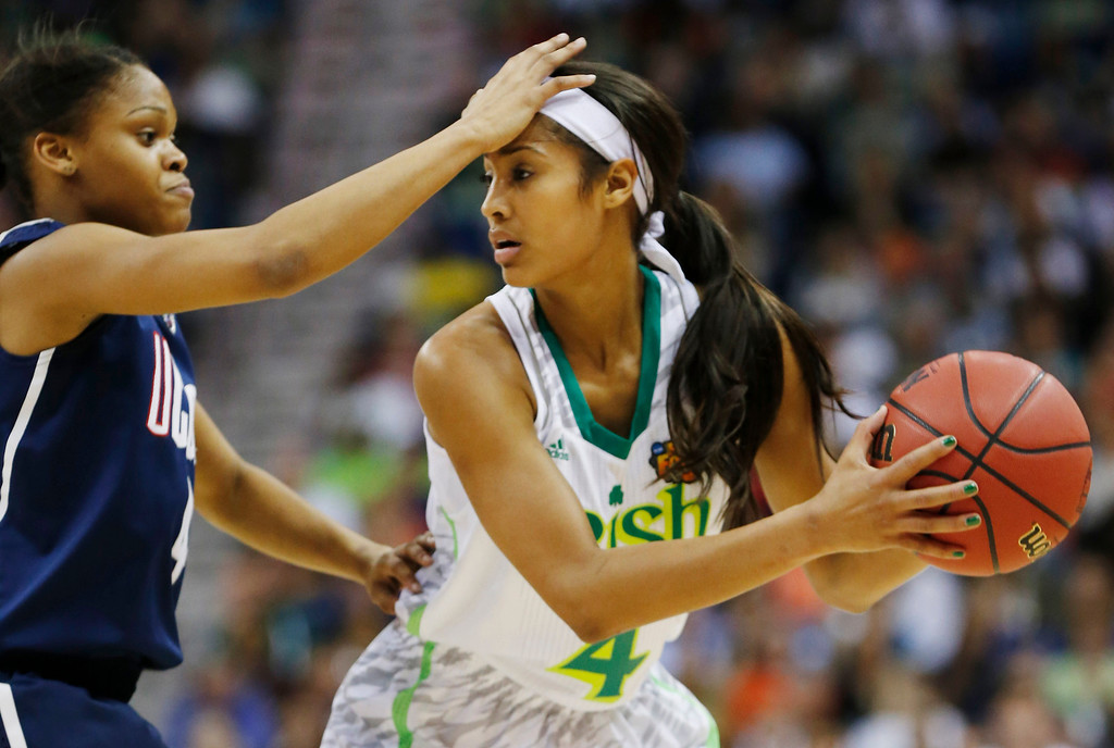 . Connecticut guard Moriah Jefferson (4) defends against Notre Dame guard Skylar Diggins (4) in the first half of the women\'s NCAA Final Four college basketball tournament semifinal, Sunday, April 7, 2013, in New Orleans. (AP Photo/Dave Martin)