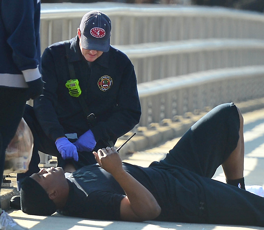 . A Charlotte firefighter tends to Carolina Panthers NFL football quarterback Cam Newton following a two-vehicle crash not far from the team\'s stadium in Charlotte, N.C., Tuesday, Dec. 9, 2014. (AP Photo/The Charlotte Observer, Todd Sumlin)