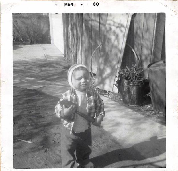 1960-03 jbb backyard working - 1.jpg