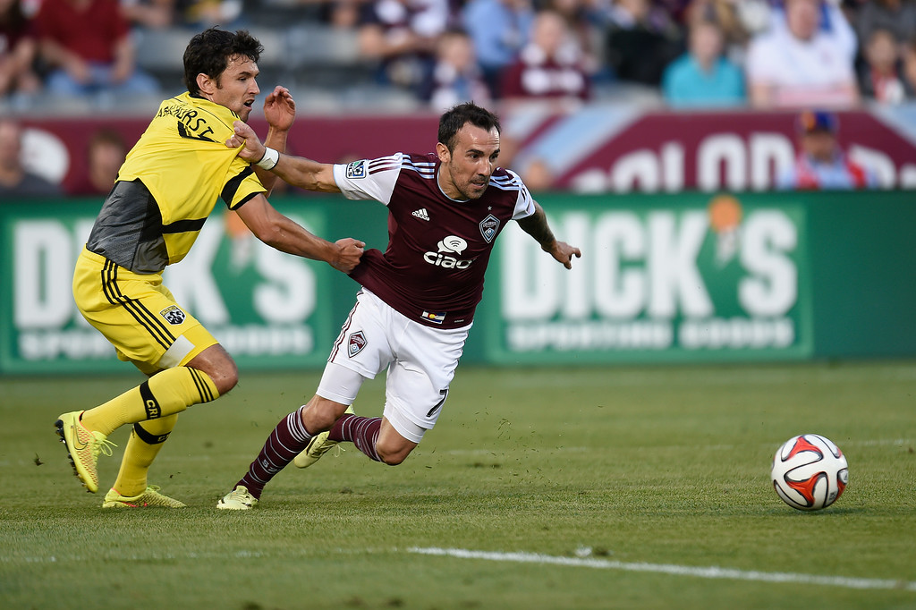 . Vicente Sánchez #7 of the Colorado Rapids battles Michael Parkhurst #4 of the Columbus Crew for the ball during an MLS game at Dick\'s Sporting Goods Park on July 4, 2014, in Commerce City, Colorado. The Rapids and Crew finished in a 1-1 draw. (Photo by Daniel Petty/The Denver Post)