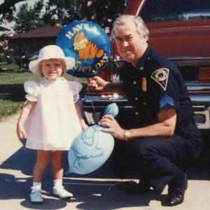 Sgt Harry E Miller and    granddaughter Misty 1985