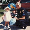 Sgt Harry E Miller and    granddaughter Misty 1985