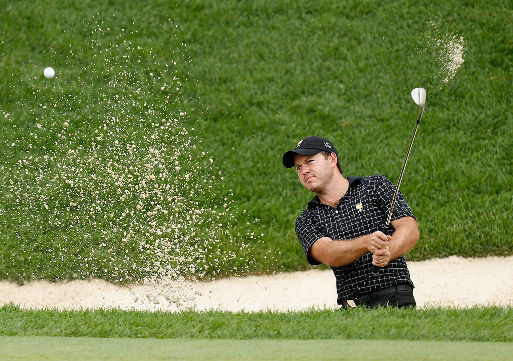 . Richard Sterne of South Africa and the International Team plays a bunker shot on the 16th hole during the Day Four Singles Matches at the Muirfield Village Golf Club on October 6, 2013  in Dublin, Ohio.  (Photo by Gregory Shamus/Getty Images)