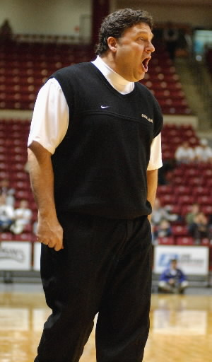 Description of . Oakland University men's basketball head coach Greg Kampe yells instructions to his team as they played Western Illinois during second half action, Saturday, March 3, 2007, at the UMAC in Tulsa, OK.  Oakland beat WIU, 74-57.  (The Oakland Press/Jose Juarez)
