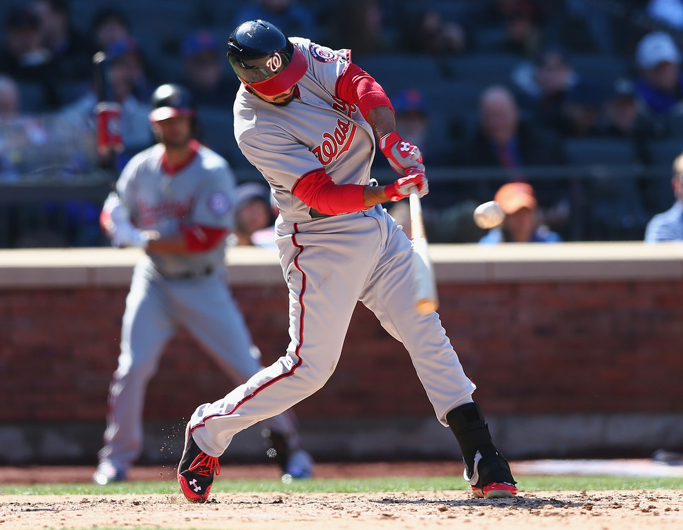. Anthony Rendon #6 of the Washington Nationals hits an RBI in the seventh inning against the New York Mets during Opening Day on March 31, 2014 at Citi Field in the Flushing neighborhood of the Queens borough of New York City.  (Photo by Elsa/Getty Images)