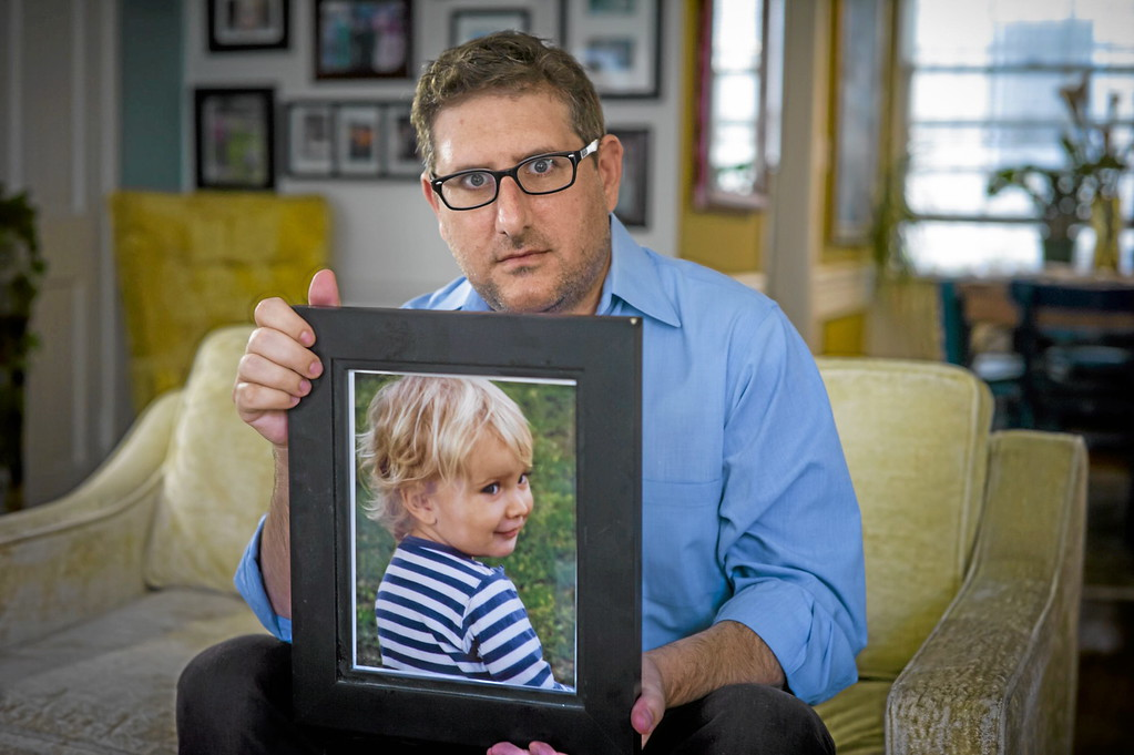 """. Larry Hummel of Beverly Hills, CA with a photo of his son Sasha, now 4, on Monday, November 11, 2013.  Hummel hasn\'t seen his son since May of last year. Hummel\'s ex-wife Maria Pfeifer, 32, of Hollywood was charged by the Los Angeles County District Attorney\'s Office in August with abducting Sasha and his half-brother Robert \""""Jerry\"""" Pfeifer, 10, after she took the children to the Czech Republic for a visit and never returned. An international hunt involving the F.B.I and the U.S. State Department is now underway to locate Maria Pfeifer.   ( Photo by David Crane/Los Angeles Daily News )"""