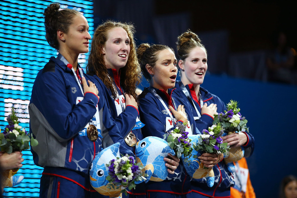 . Gold Medal winners Megan Romano, Shannon Vreeland, Natalie Coughlin and Missy Franklin of the USA celebrate on the podium after the Swimming Women\'s4x100mFreestyle on day nine of the 15th FINA World Championships at Palau Sant Jordi on July 28, 2013 in Barcelona, Spain.  (Photo by Al Bello/Getty Images)