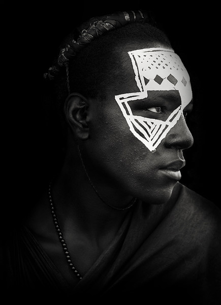 Portrait of a young Masai during his right of passage ceremony.  Tanzania, 2019