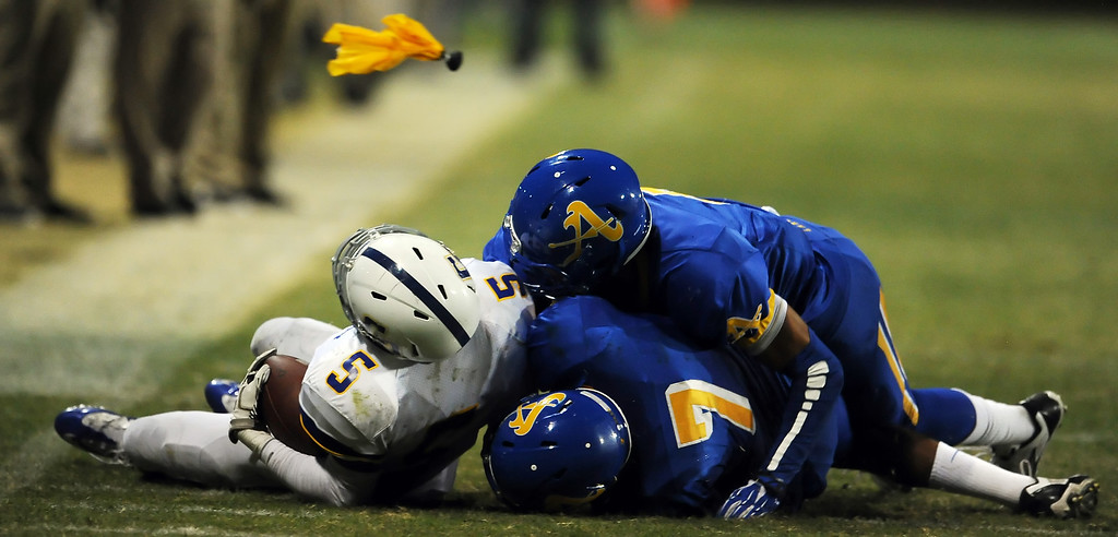 . Bishop Amat defense tackles Charter Oak\'s Todd Greene (5) as a flag is tossed in the first half of a prep football game at Bishop Amat High School in La Puente, Calif. on Friday, Sept. 20, 2013.    (Photo by Keith Birmingham/Pasadena Star-News)
