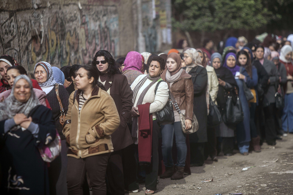. Egyptian women queue up to cast their vote on a new constitution in Al-Haram in the southern Cairo Giza district on January 14, 2014. The military-installed government implored voters to turn out en masse to ratify the constitution, with the country\'s lingering polarization underscored by the explosion of a small bomb in Cairo that caused no injuries. (MAHMOUD KHALED/AFP/Getty Images)