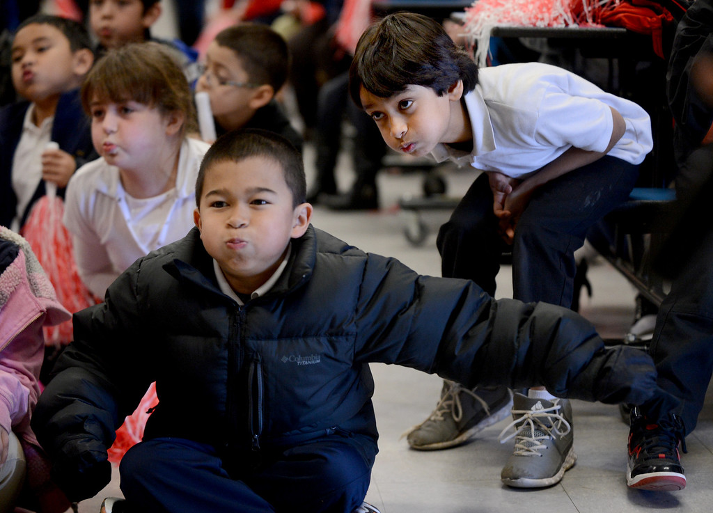 ". Anthony Ybrite, center, Kaitlyn Kimmel, left, and Aadel Saleem give it their best as they blow air to make wind pressure during a ""Science Rocks\"" assembly held at El Monte Elementary School in Concord, Calif., on Tuesday, Feb. 26, 2013.  (Susan Tripp Pollard/Staff)"