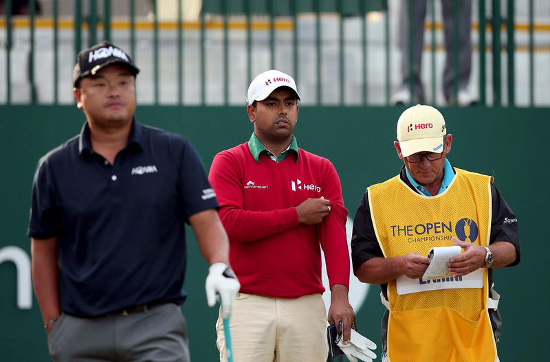 """. India\'s Anirban Lahiri (C) waits on the 1st tee during his first round on the opening day of the 2014 British Open Golf Championship at Royal Liverpool Golf Course in Hoylake, north west England on July 17, 2014. England\'s former Ryder Cup star David Howell got the 143rd British Open underway just after the crack of dawn at Royal Liverpool Golf Club on Thursday with all eyes early on riveted on a \""""fit again\"""" Tiger Woods. (ANDREW YATES/AFP/Getty Images)"""