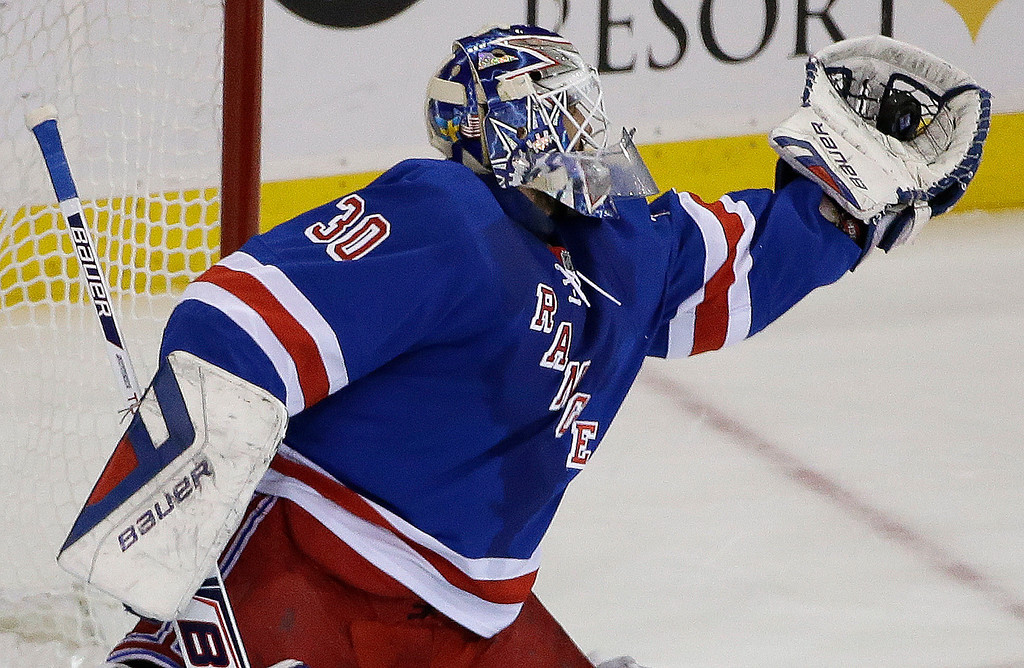 . New York Rangers goalie Henrik Lundqvist (30) snags a shot on goal by the Montreal Canadiens during the first period in Game 6 of the NHL hockey Stanley Cup playoffs Eastern Conference finals, Thursday, May 29, 2014, in New York. (AP Photo/Frank Franklin II)