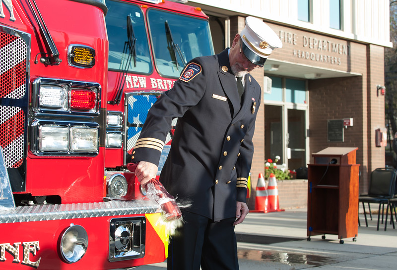 11/14/18  Wesley Bunnell | Staff  The New Britain Fire Department unveiled three new fire trucks on Wednesday afternoon during a ceremony at their Beaver St headquarters.  Deputy Chief Peter Margentino smashes a bottle of champagne on Engine 2 and is nicknamed Pride of the South.