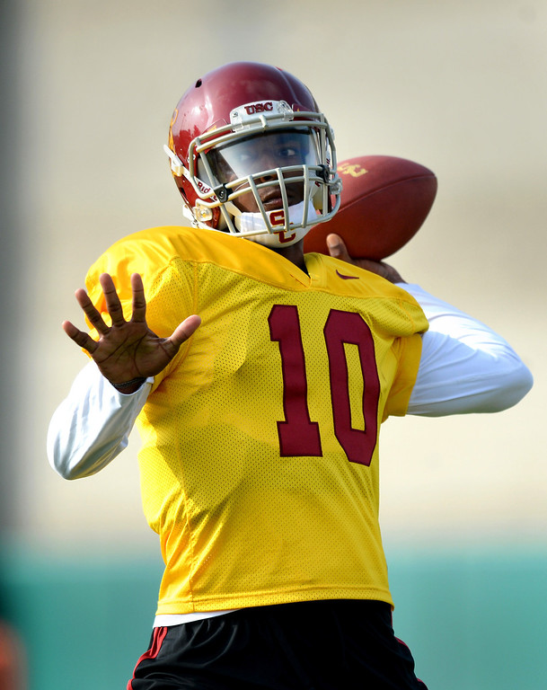 . USC QB Jalen Greene throws a pass during practice, Tuesday, March 25, 2014, at USC. (Photo by Michael Owen Baker/L.A. Daily News)