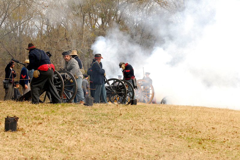 "Smoke obscures the canon in the distance as Union artillery reenactors fire ""volleys"" across the battlefield. The Skirmish at Gamble's Hotel happened on March 5, 1885 when 500 federal soldiers, under the command of Reuben Williams of the 12th Indiana Infantry, marched into Florence to destroy the railroad depot but were met by Confederate soldiers backed up with 400 militia. The reenactment, held by the 23rd South Carolina Infantry, was held at the Rankin Plantation in Florence, South Carolina on Saturday, March 5, 2011. Photo Copyright 2011 Jason Barnette"