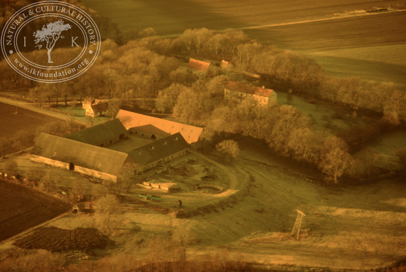 Araslöv manor house and church with farmland. Experimentally photographed with yellow filter (19 November, 1988). | LH.0237