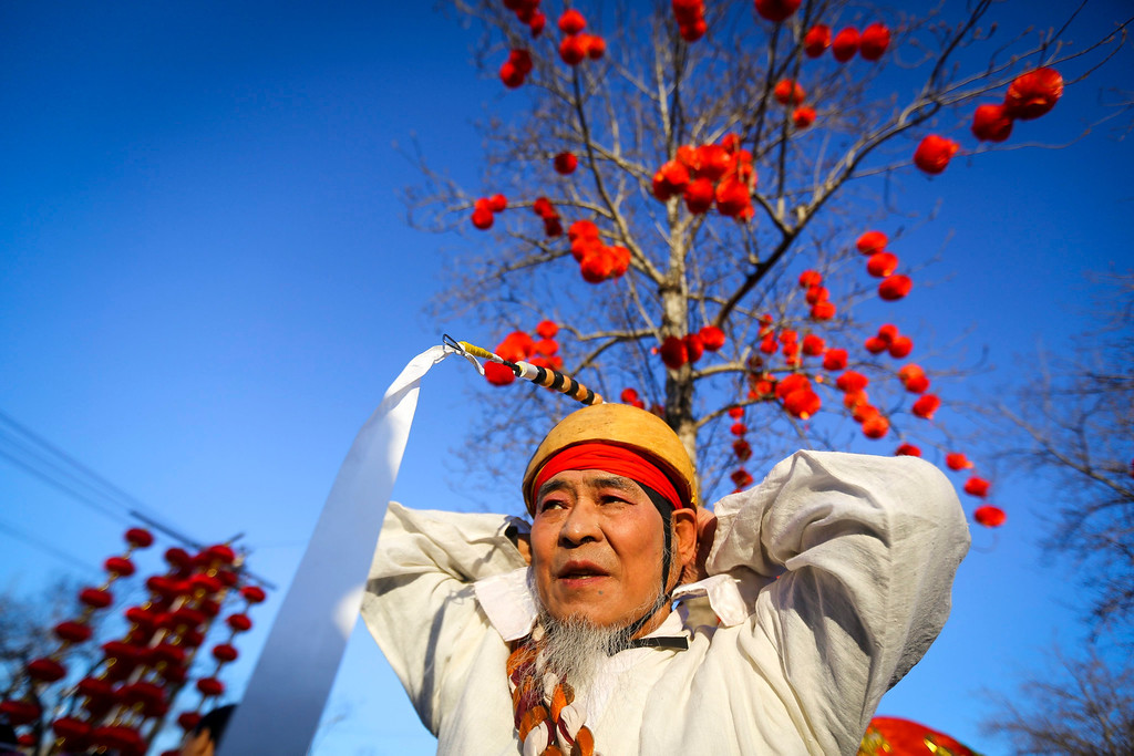 . A performer in traditional costume gets ready for his performance on the eve of the Lunar New Year, or Spring Festival, at a park fair in Beijing, China, 30 January 2014.   EPA/DIEGO AZUBEL
