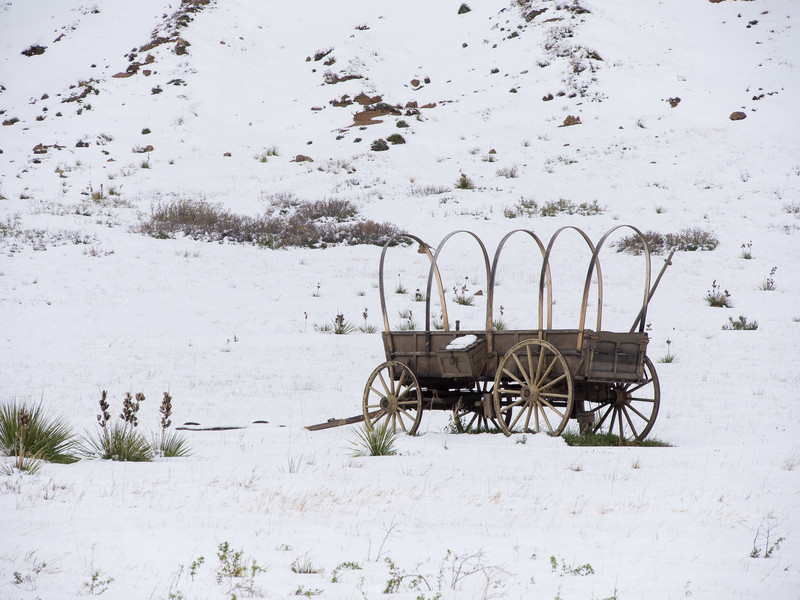 Example of a 19th Century Old Covered Wagon in Snow
