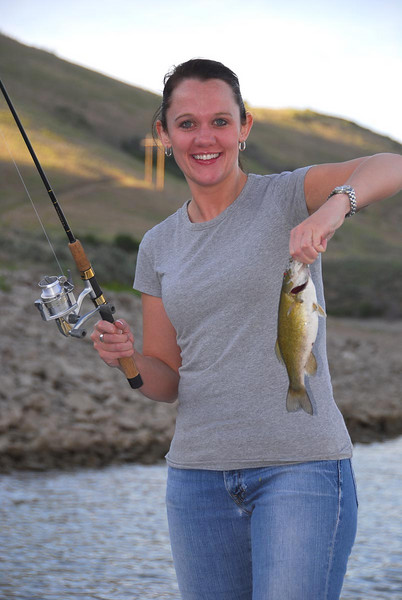 6/14/07 – In the evening a few of us went fishing on Deer Creek reservoir on our CEO's boat. We picked up a few small mouth bass along the rocky shorelines. This is Heather our legal council and head of HR and training.