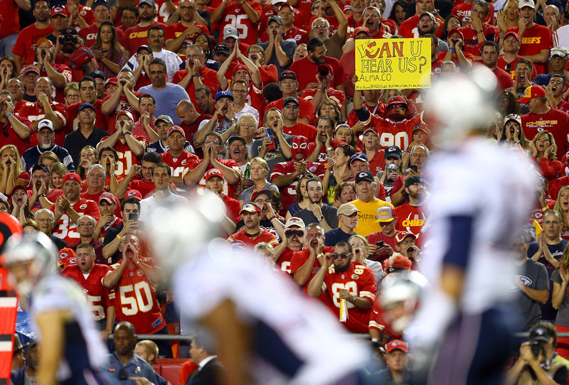 . Fans cheer during the first quarter of the Kansas City Chiefs vs the New England Patriots game at Arrowhead Stadium on September 29, 2014 in Kansas City, Missouri.  (Photo by Dilip Vishwanat/Getty Images)