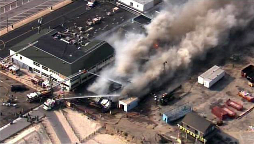 Description of . Firefighters battle a raging fire on boardwalk in Seaside Park, N.J., Thursday, Sept. 12, 2013. The fire apparently started in an ice cream shop then spread several blocks down a New Jersey shore boardwalk that was damaged in Superstorm Sandy and was being repaired. (AP Photo/Fox 29)