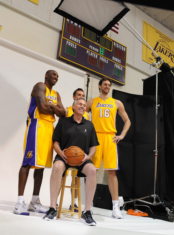 . Kobe Bryant, Steve Nash, Pau Gasol and Mike D\'Antoni pose for the Lakers photographer. The Los Angeles Lakers held a media day at their El Segundo practice facility. Players were photographed for team materials, and interviewed by the press. El Segundo, CA. 9/27/2013. photo by (John McCoy/Los Angeles Daily News)