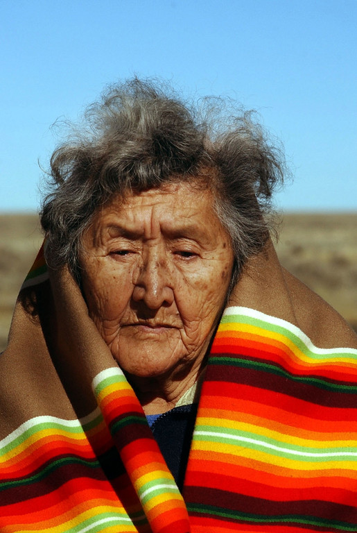 . Lucille Hamilton Youngbull, age 76, from Oklahoma joins a sunrise pipe ceremony at the sight of the Sand Creek Massacre on Thursday, Nov. 28, 2002.  Hamilton\'s great grandmother survived the massacre. (The Denver Post/ Hyoung Chang)