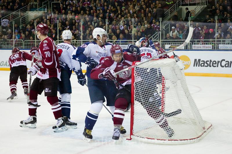 Dmitry Semin (42) of Torpedo Nizhny Novgorod pushes Gunars Skvorcovs (13) into the goal