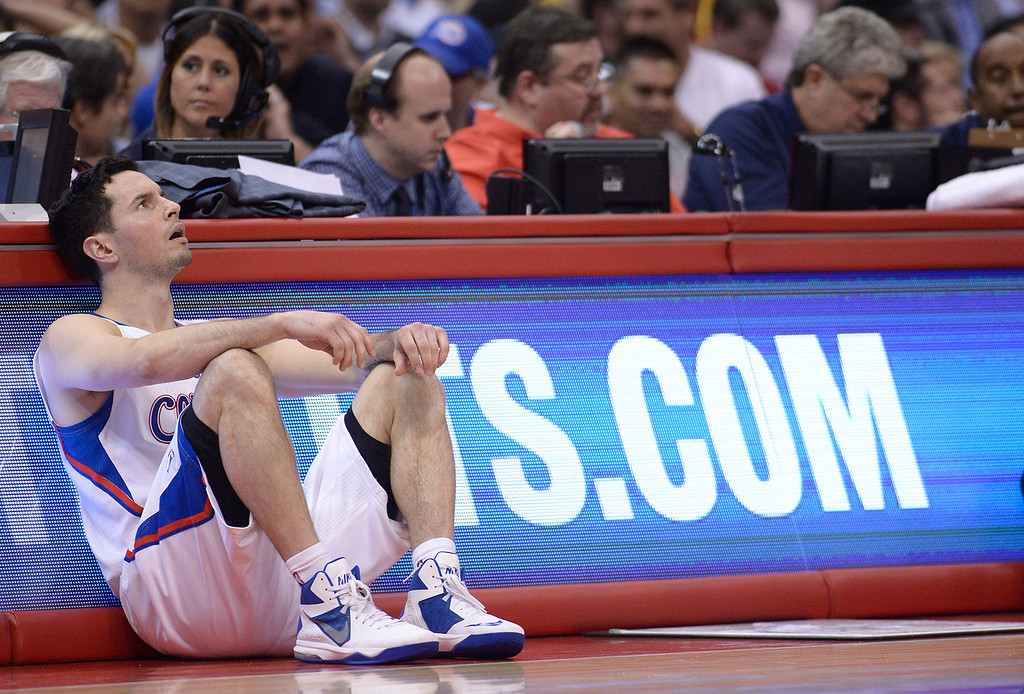 . Clippers#4 J.J. Redick waits to go back into the game in the 4th quarter. The Oklahoma City Thunder defeated the Clippers 107-101 in a regular season game at Staples Center in Los Angeles, CA. 4/9/2014(Photo by John McCoy / Los Angeles Daily News)