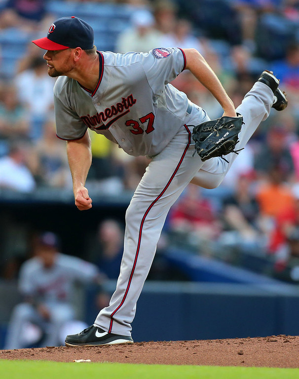 . Minnesota Twins starter Mike Pelfrey delivers a pitch against the Atlanta Braves during the first inning. (Curtis Compton/Atlanta Journal-Constitution/MCT)