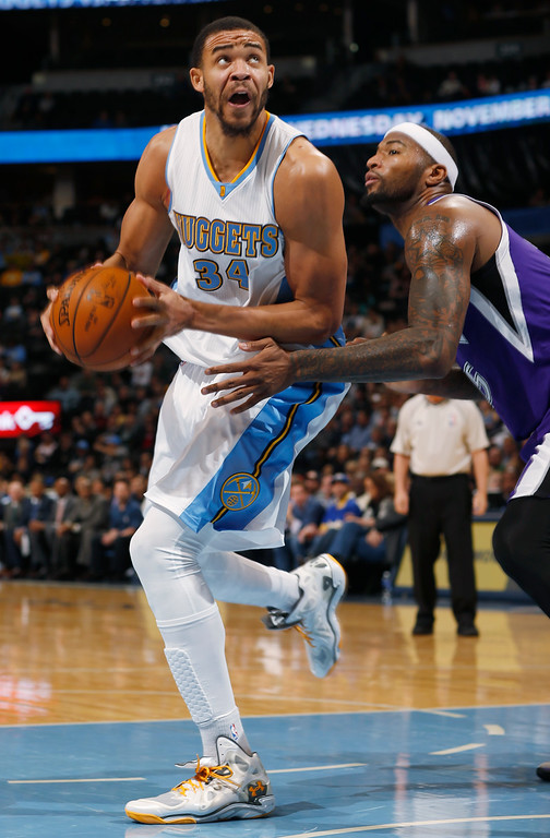 . Denver Nuggets center JaVale McGee, left, turns for shot as Sacramento Kings center DeMarcus Cousins covers in the third quarter of the Kings\' 110-105 victory in an NBA basketball game in Denver on Monday, Nov. 3, 2014. (AP Photo/David Zalubowski)