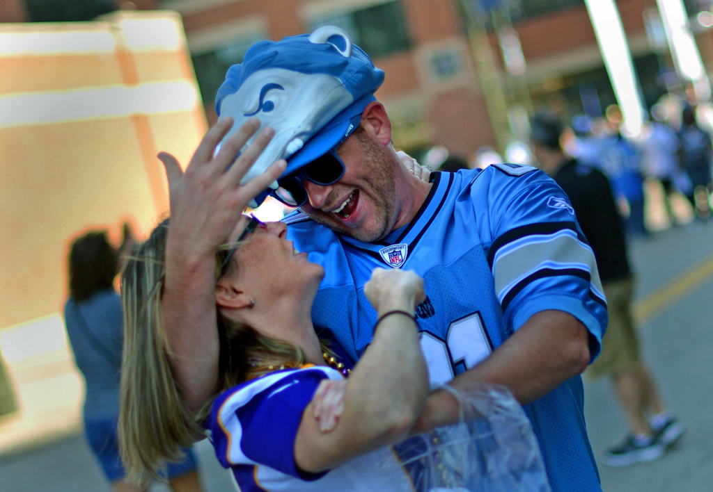 . Wingham, Ontario, residents Jess Metcalfe, wearing an Adrian Peterson jersey, and friend Brent Robinson, wearing a Calvin Johnson jersey, get a little playful  outside of Ford Field prior to the start of the Vikings-Lions game.  (Pioneer Press: Chris Polydoroff)