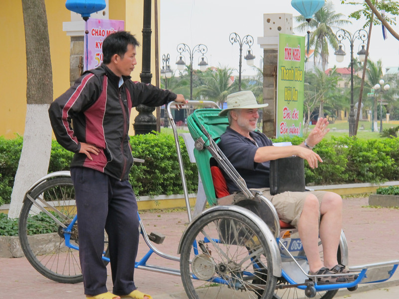 Tom Olinyk in a Cyclo (tricycle rickshaw).