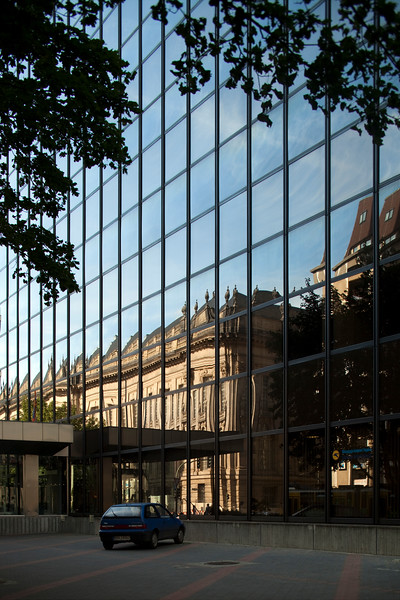 19th century building reflected on a contemporary glass building, Friedrichstrasse, Berlin, Germany