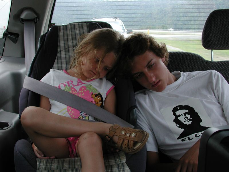Stormie and Josh watch a movie from the little TV in moms van on the way back home from JFK Airport in New York City.
