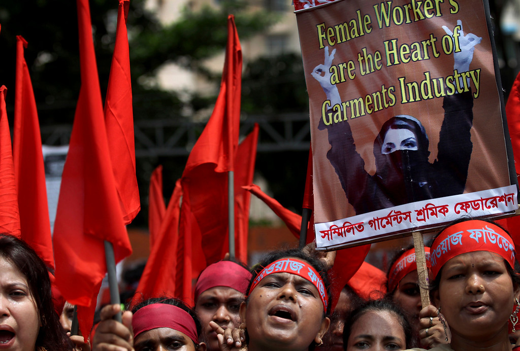 . Women protesters shout slogans during a May Day rally on Wednesday May 1, 2013 in Dhaka, Bangladesh. Thousands of workers paraded through central Dhaka on May Day to demand safer working conditions and the death penalty for the owner of a building housing garment factories that collapsed last week in the country\'s worst industrial disaster, killing at least 402 people and injuring 2,500. (AP Photo/Wong Maye-E)