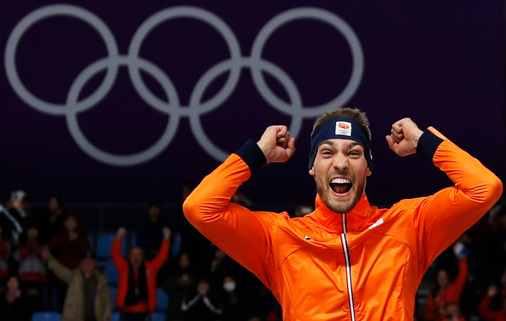 . Gold medallist Kjeld Nuis of The Netherlands celebrates on the podium after the men\'s 1,500 meters speedskating race at the Gangneung Oval at the 2018 Winter Olympics in Gangneung, South Korea, Tuesday, Feb. 13, 2018. (AP Photo/John Locher)