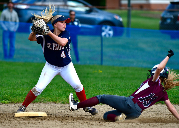 5/15/2019 Mike Orazzi | Staff St. Paul's Ava Hampton (4) forces out Farmington's Carolyn Piera (13) at second in Bristol Wednesday.
