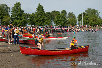 2009 Ottawa Riverkeeper Triathlon. Canoeists and kayakers preparing for an event. Swimmers in the background acclimatizing to the water in anticipation of their upcoming event.  © Rob Huntley