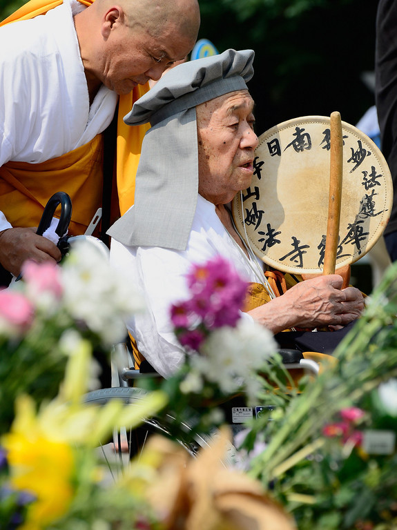 . Buddhist monks pray for victims of the 1945 atomic bombing in front of the cenotaph at the Peace Memorial Park in Hiroshima on August 6, 2013 as ceremonies are held to mark the 68th anniversary of the bombing.  AFP PHOTO / TORU  YAMANAKA/AFP/Getty Images