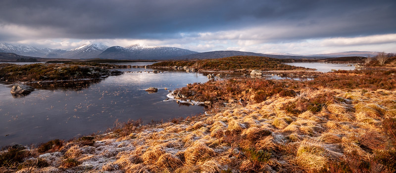 Frozen lake and mountains in the Highlands of Scotland
