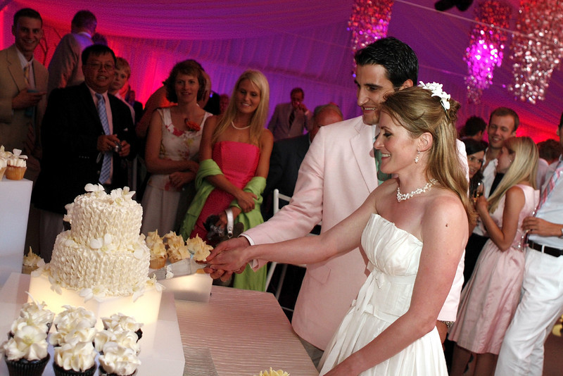 Bride and groom cut the cake at their night club themed Cape Cod wedding. - Home - The Casual Gourmet, Cape Cod Wedding Caterer