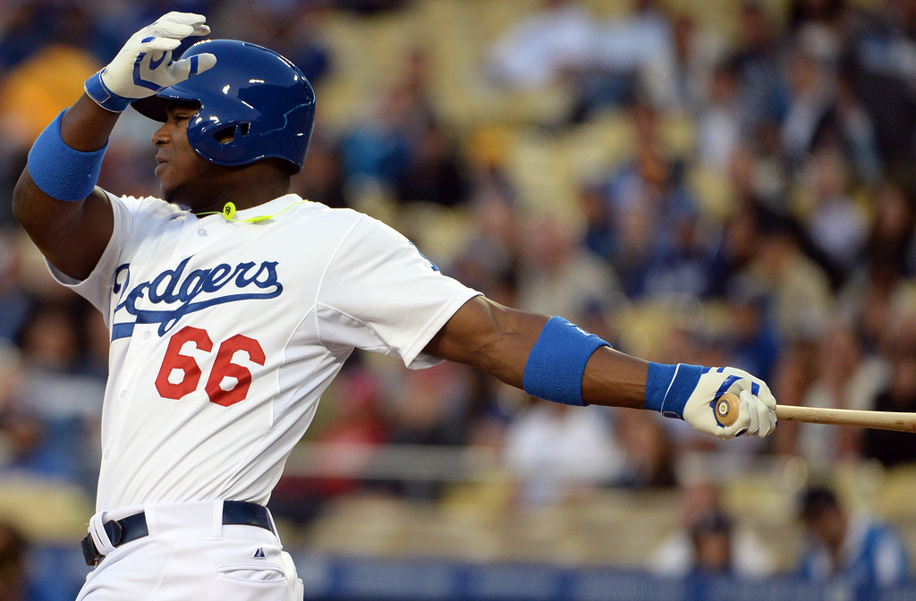 . Los Angeles Dodgers\' Yasiel Puig watches his double in the first inning of a baseball game against the Philadelphia Phillies on Tuesday, April 22, 2013 in Los Angeles.   (Keith Birmingham/Pasadena Star-News)
