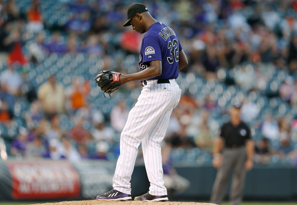 . Colorado Rockies relief pitcher LaTroy Hawkins reacts after giving up back-to-back RBI singles to allow the San Francisco Giants to tie the score in the ninth inning of the Rockies\' 10-9 victory in a baseball game in Denver on Monday, Sept. 1, 2014. (AP Photo/David Zalubowski)