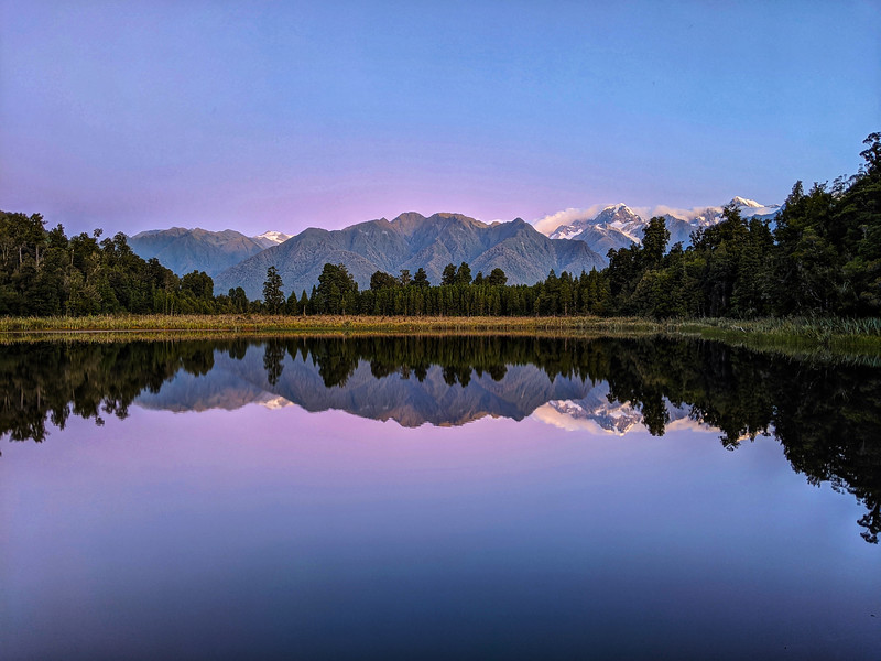 A perfect sunset over Lake Matheson. Our guide from made sure we stuck around to get a great shot!