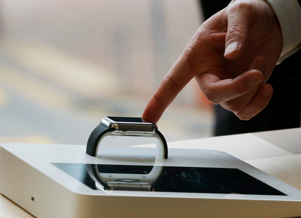 . A customer touches an Apple Watch at an Apple Store in Hong Kong Friday, April 10, 2015. From Beijing to Paris to San Francisco, the Apple Watch made its debut Friday. Customers were invited to try them on in stores and order them online. (AP Photo/Kin Cheung)
