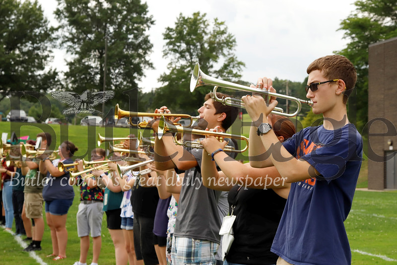 Ronald Braho (right), Alexandrea Frazier, James Brenneman and the Slippery Rock High School marching band horns section warm up during practice Wednesday at Slippery Rock Middle School. 082119 Seb Foltz/Butler Eagle
