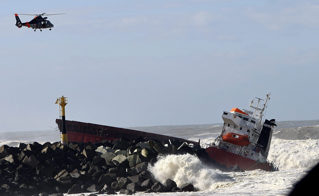 . Spanish freighter Luno hits the breakwater and is split in half near Bayonne, south west France 5 February 2014.   All crew members were winched to safety by helicopter. With the wreck leaking fuel, a pollution alert was declared  EPA/Javier Etxezarreta